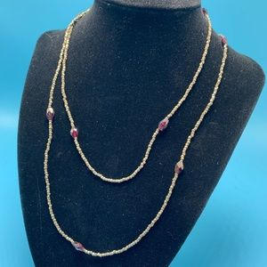 Long necklace shown doubled can be one long strand